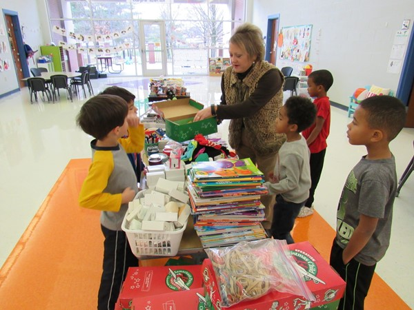 Mrs. Valentine and Panther Academy students filling Christmas boxes.