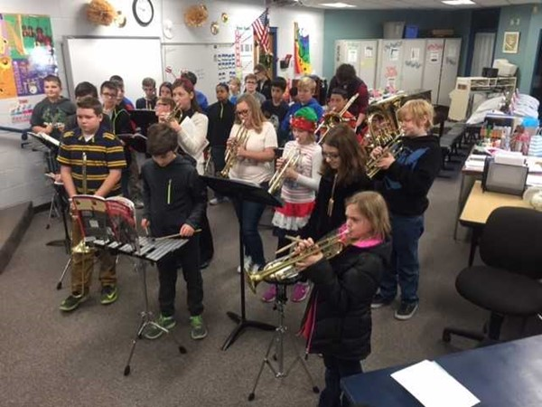 Mrs. Evans and her 6th grade band students from TK Stone Middle School practiced spreading good cheer to students at Morningside Elementary School during the last few days before Christmas Break.