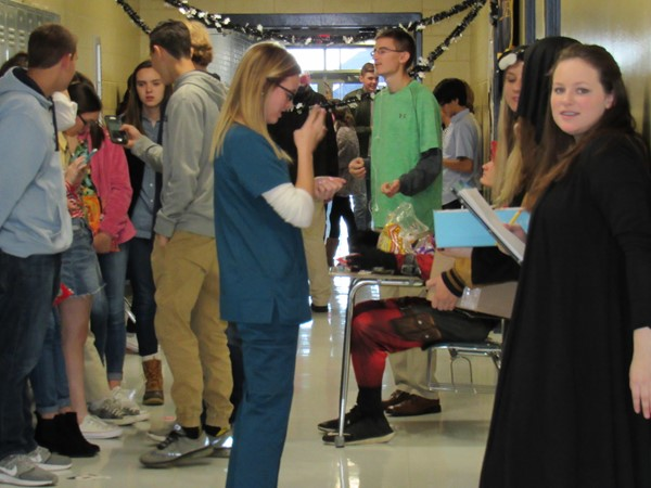 EHS students line the hall at Halloween to trick or treat with Panther Academy students.