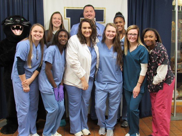 Mr. Smallwood, Principal at EHS, with 8 students all dressed as doctors for Halloween.