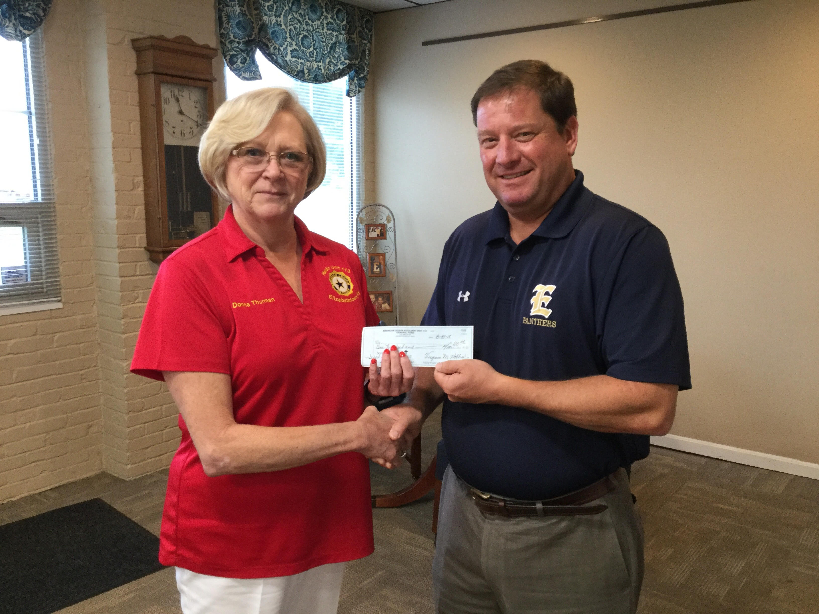 American Legion Representative and Mr. Jon Ballard, Superintendent receiving the check on behalf of EIS students.